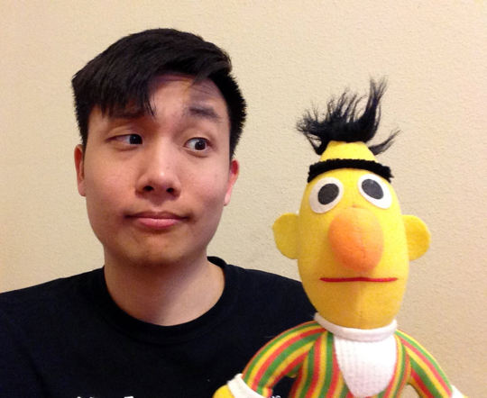 Photo of Bert the designer looking at Bert the Muppet.