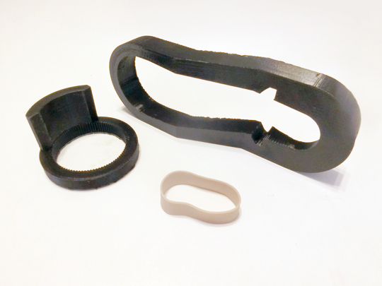 Three components. A 3D-printed lever in the shape of a elongated loop. A 3D-printed ring the size of a doorknob with an extrusion that fits into a notch on the lever. A rubber band.