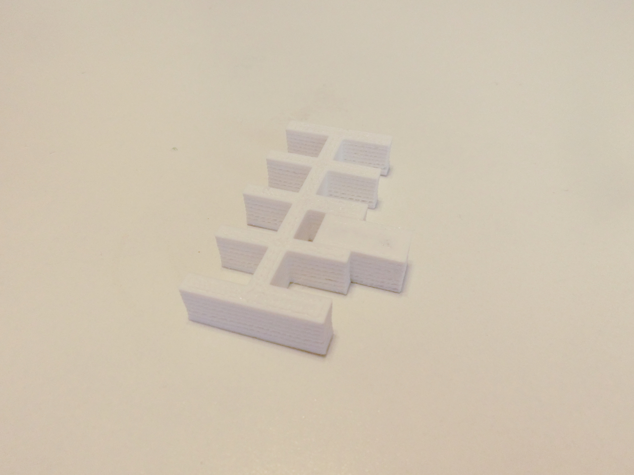 3D print of a form with several notches and another form to test the notches